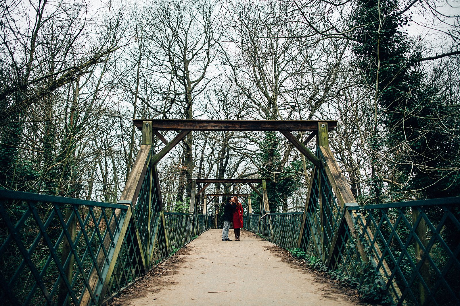 couple standing on the bridge kissing