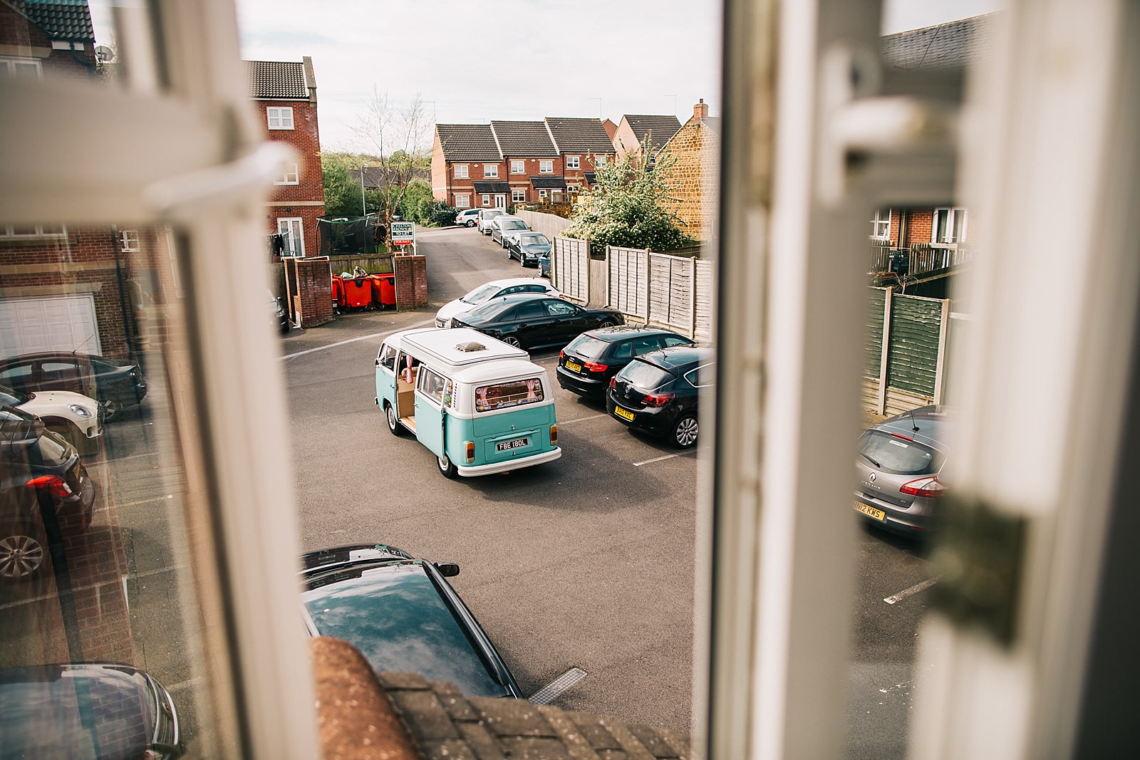 photo of a mint camper van from the window