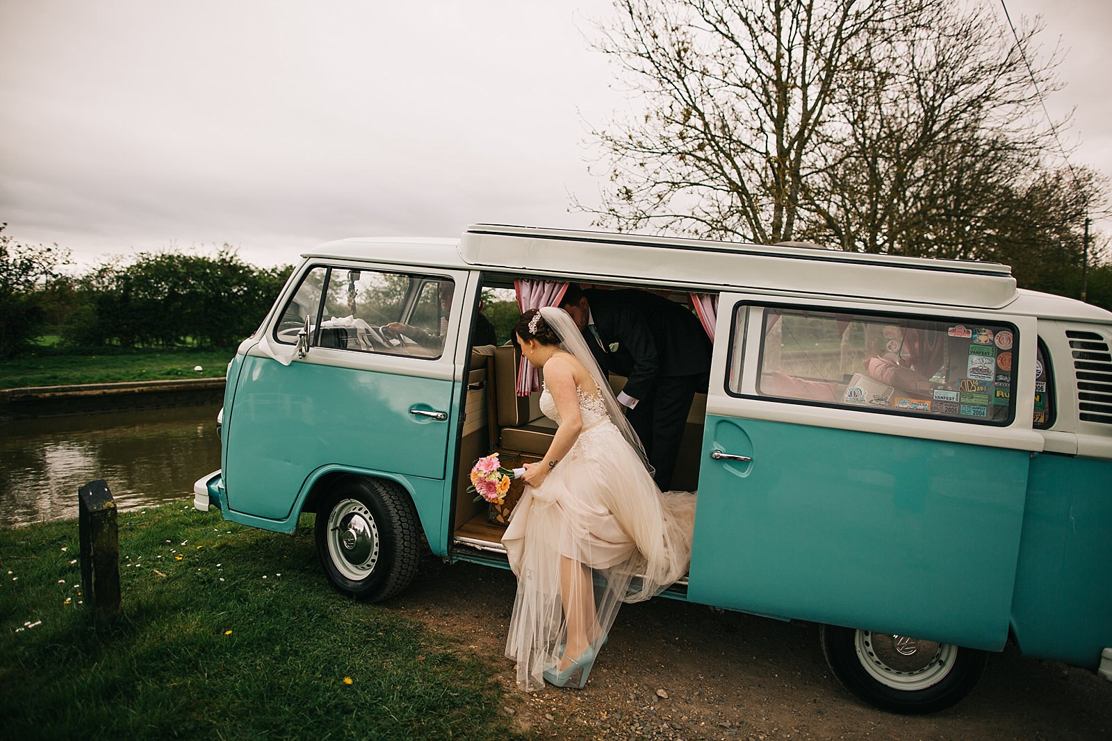 bride getting out of the camper van by the river