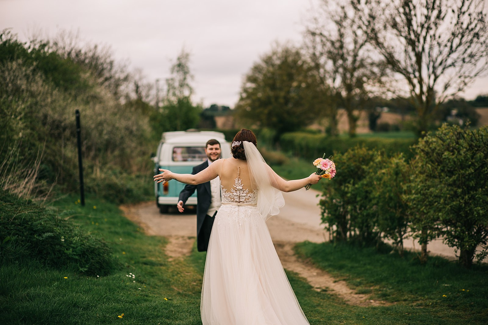 bride walking towards groom with open arms