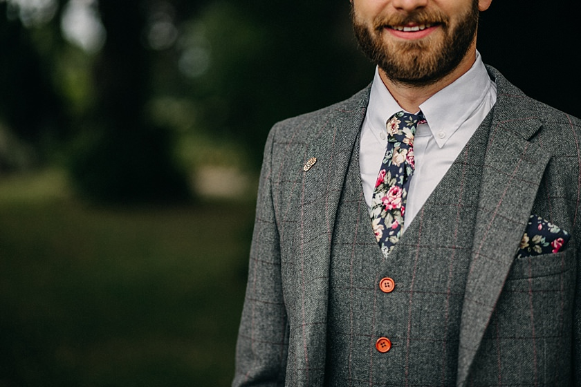 photograph of grooms flowery tie close up photographed by Wedding Photographer Buckinghamshire