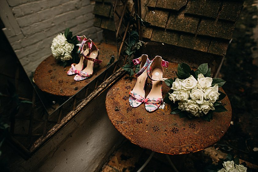 pink wedding shoes and bouquet on the table photographed by Wedding Photographer Buckinghamshire
