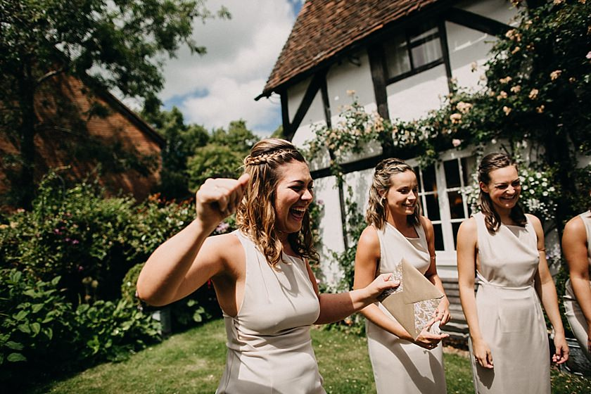 bridesmaid standing in the garden and laughing