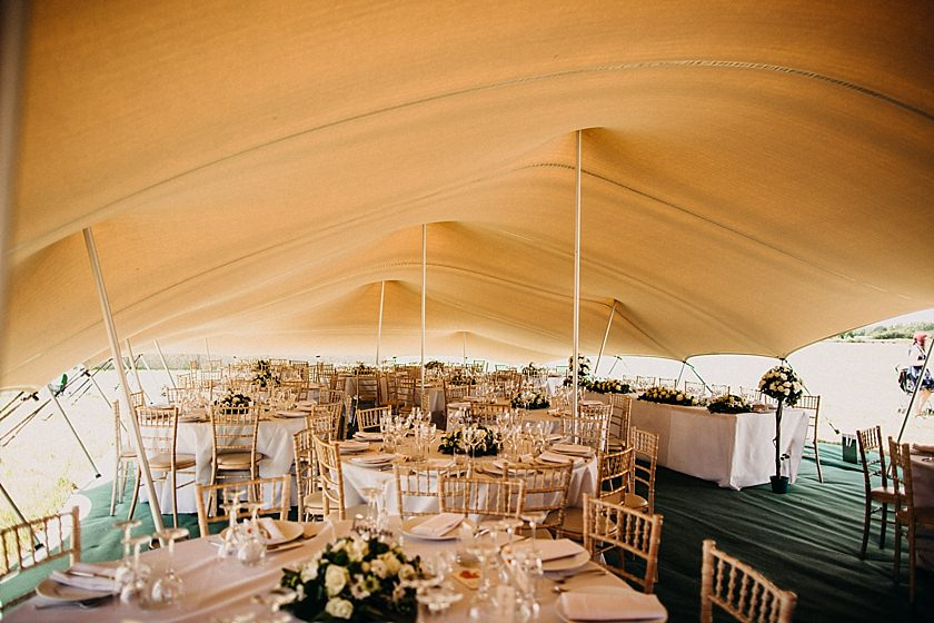 tables inside stretch tent