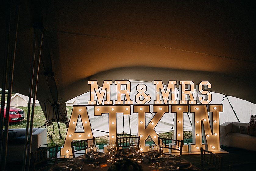 mr and mrs atkin sign inside the tent