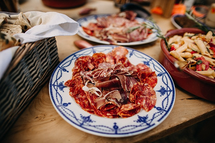 cured meat on a blue plate