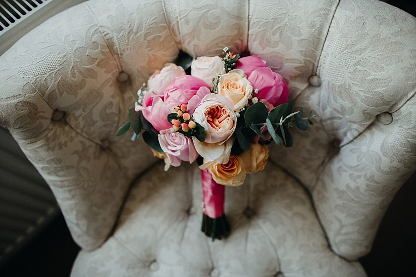 wedding flowers on the chair photographed by Wedding Photography At The Granary Estates