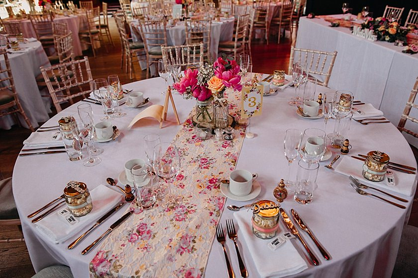 round table decorated with flowers and wedding favours