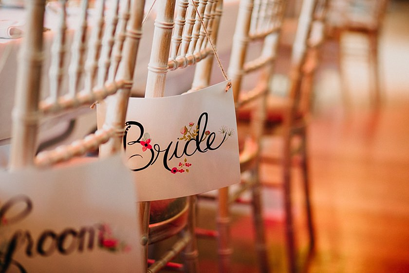 bride sign hanging on the back of a chair