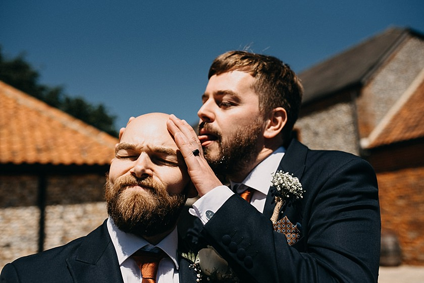 best man licking grooms head