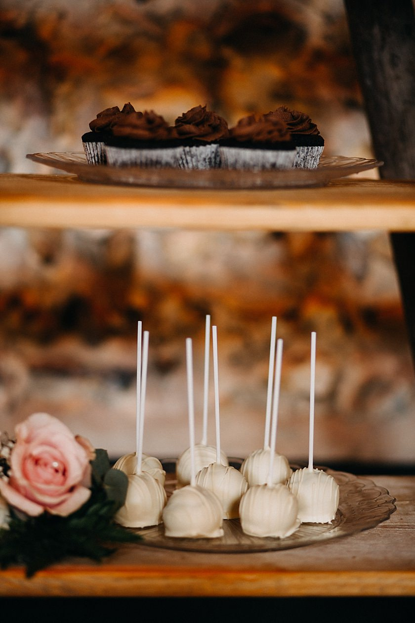 photo of cakes on plate photographed by Wedding Photography At The Granary Estates