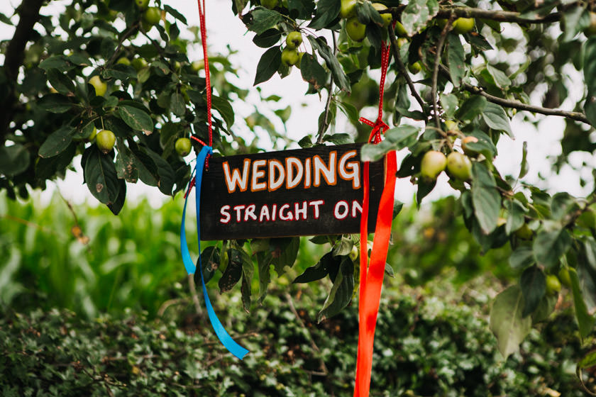 wedding straight on sign hanged on a tree