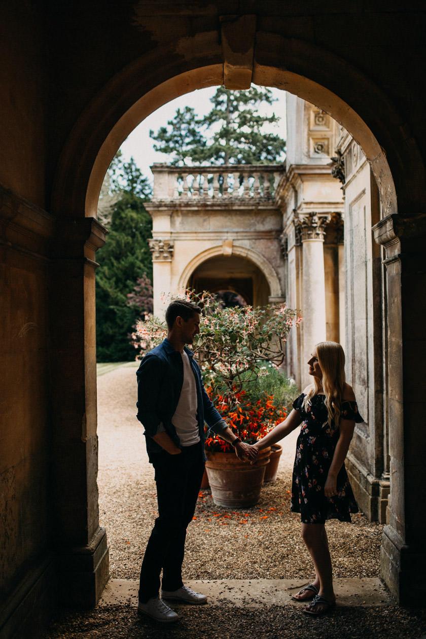 boy and girl standing apart holding hands in door frame