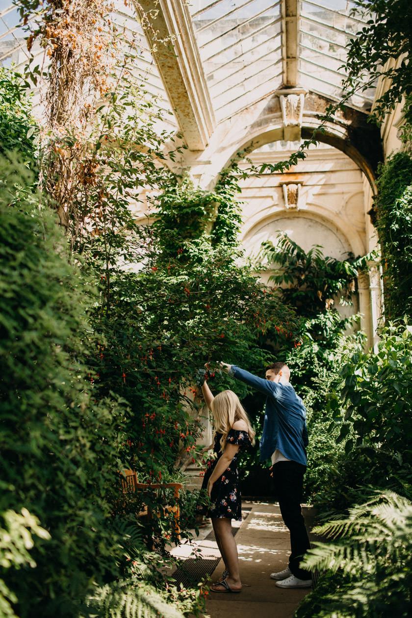 boy spinning girl around in the orangery
