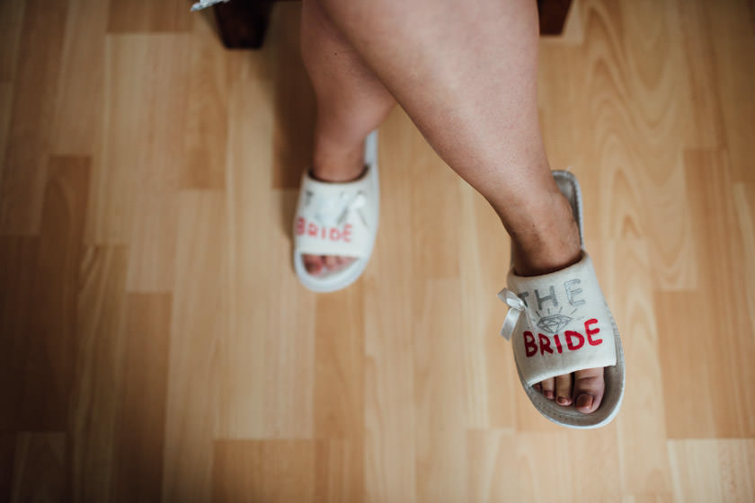 Custom bridal footwear saying 'The Bride'.