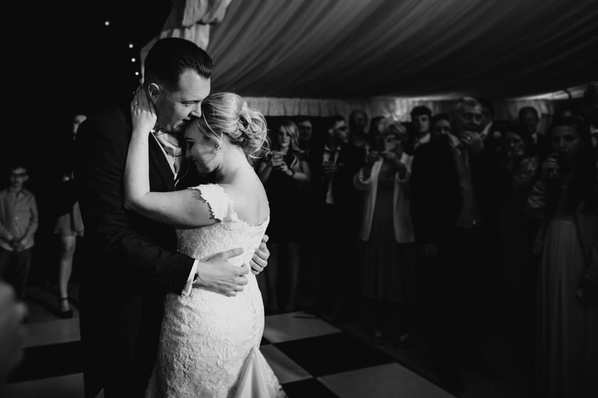 black and white photo of a newly wed couple on a dancefloor