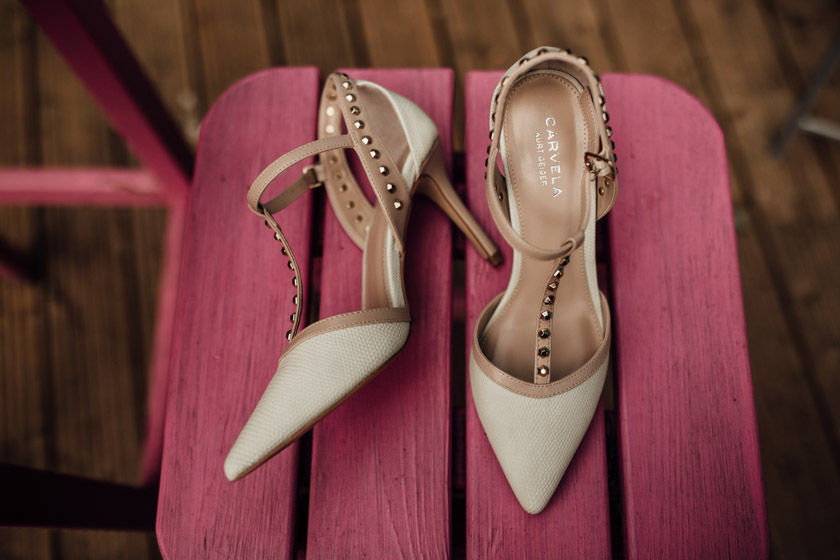 wedding shoes on pink wooden chair photographed by Park Farm Wedding Photographer