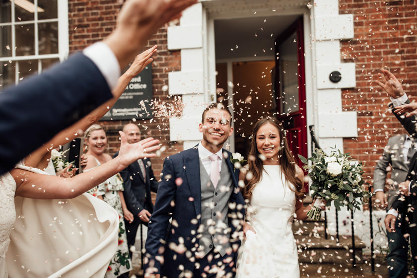 bride and groom and lots of confetti photographed by Nottingham Wedding Photographer