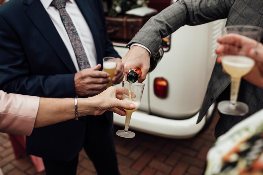 photo of champagne being poured into glasses and hands Nottingham Wedding Photographer