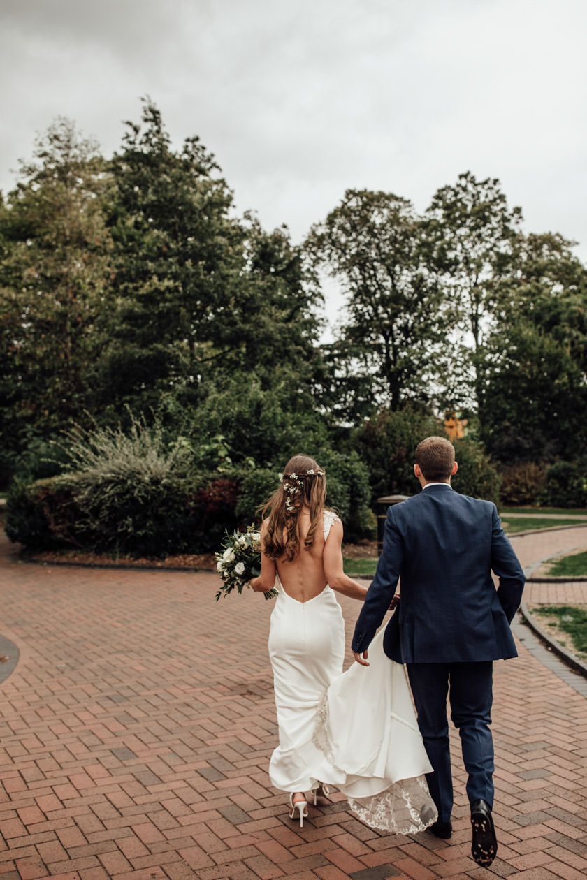 bride and groom walking photographed by Nottingham Wedding Photographer