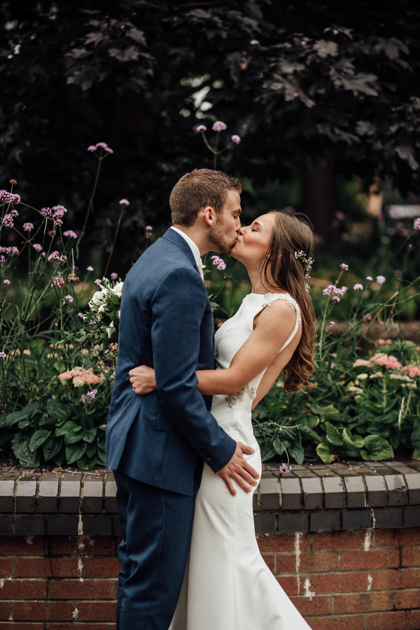 bride and groom kissing photographed by Nottingham Wedding Photographer