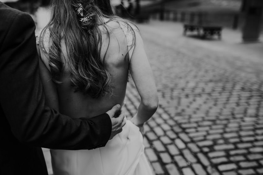groom holding onto brides back photographed by Nottingham Wedding Photographer