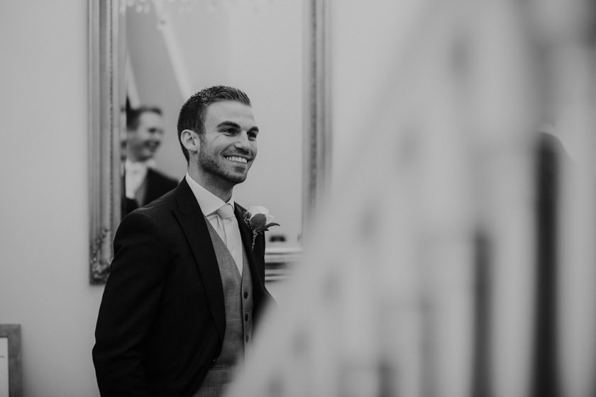 black and white photo of groom smiling photographed by Nottingham Wedding Photographer