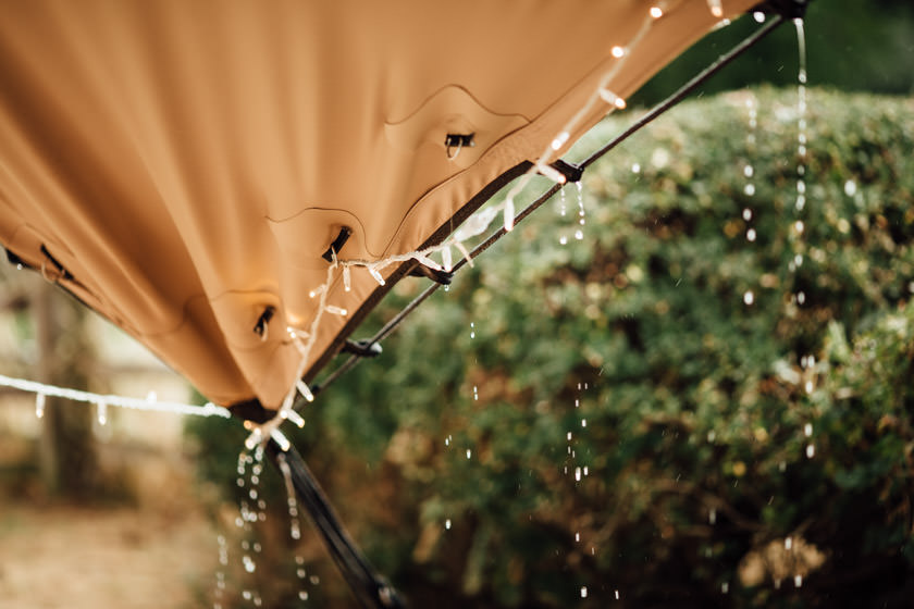 rain dripping down the side of a stretched tent photographed by Wedding Photography Northampton