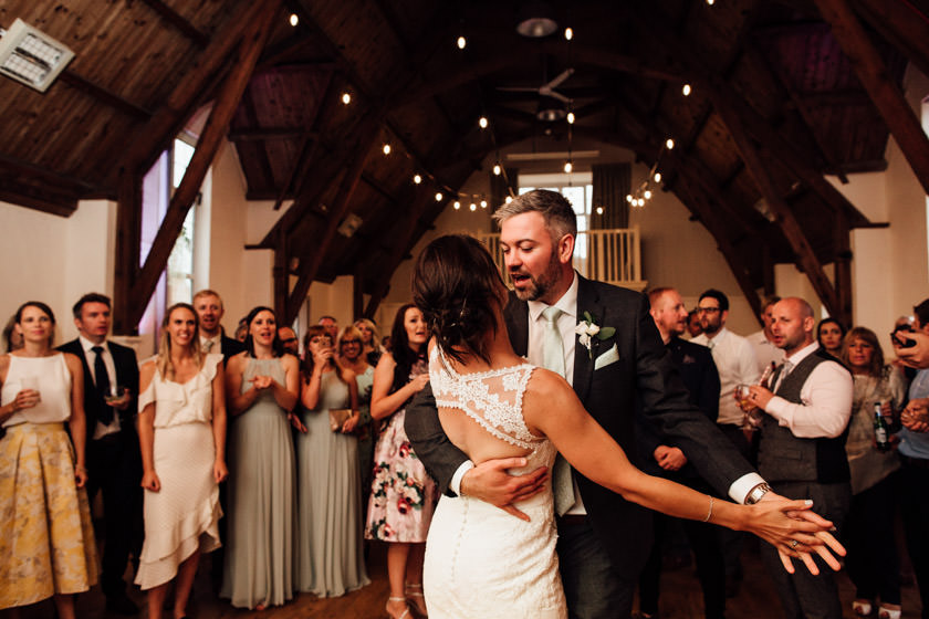 bride and groom dancing surrounded by guests photographed by Wedding Photography Northampton