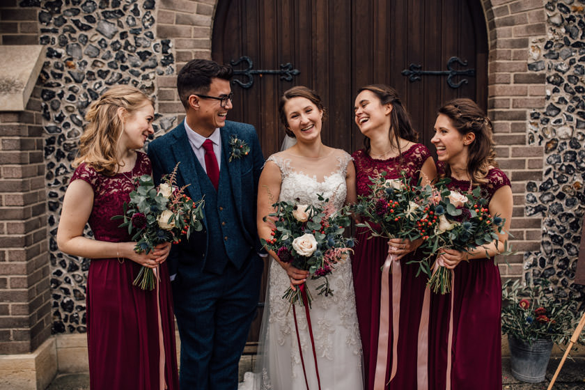 bride with bridesmainds in burgundy coulour dresses