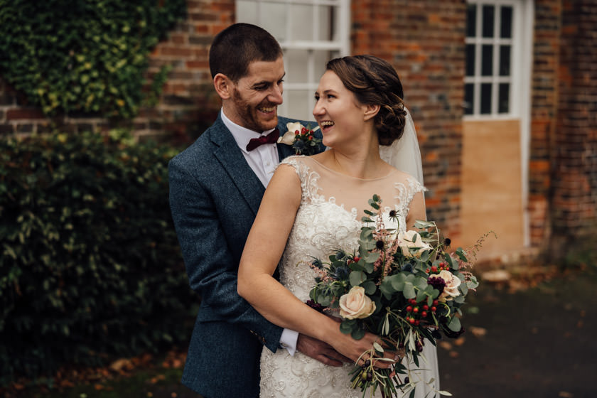 bride and groom in a hug at offley place wedding