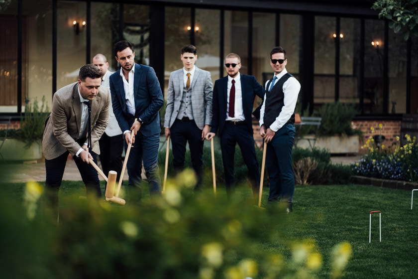 men playing golf The Granary Barns Wedding Photos