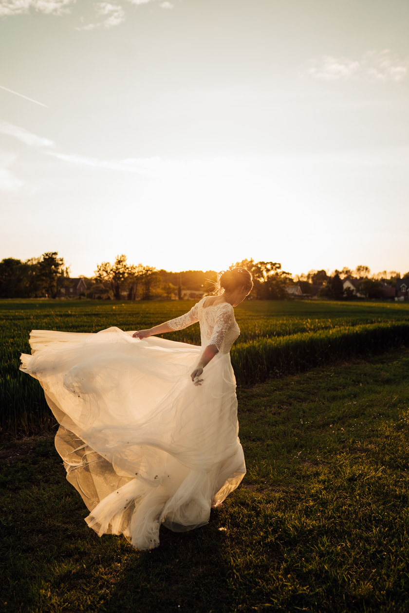 bride on field during sunset