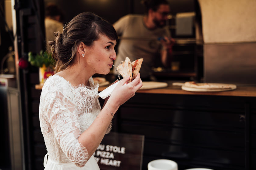bride eating a pizza The Granary Barns Wedding Photos