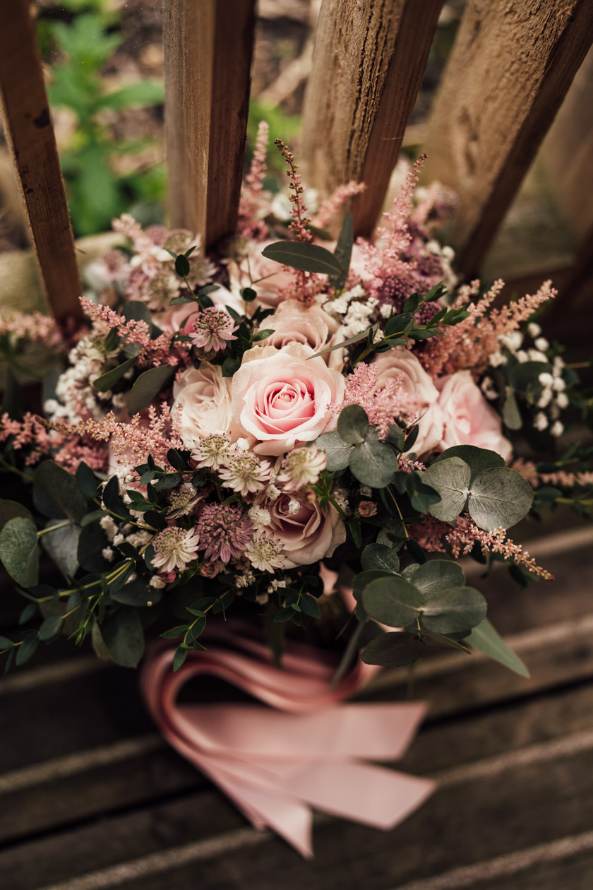 pink wedding bouquet with dusty pink ribbon