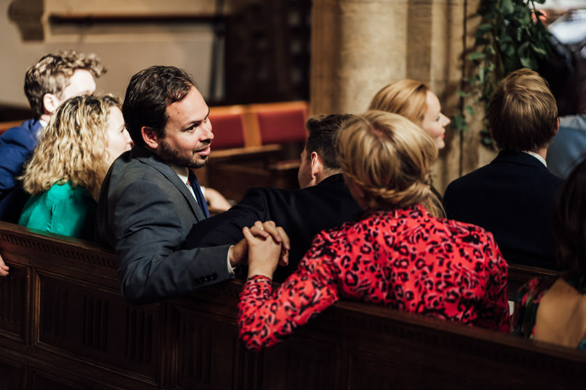 man and woman holding hands at the church