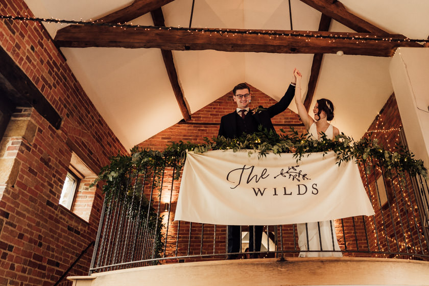 bride and groom holding hands at Dodmoor House